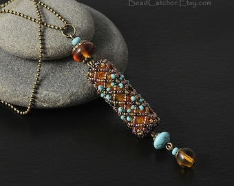 Amber and turquoise netted pendant