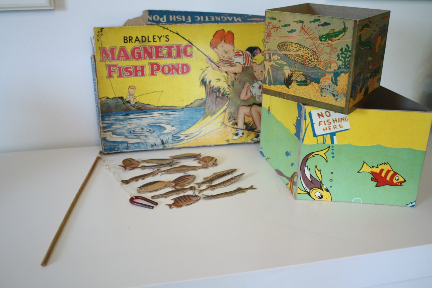 Vintage game bradley 39 s magnetic fish pond 1920s for Koi pond game online