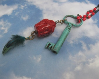 Buddha bead and feather on brass chain zen necklace boho verdigris key red beads