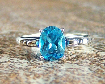 Genuine Swiss Blue Topaz 8x6mm Sterling Silver Scroll Ring, Cavalier Creations