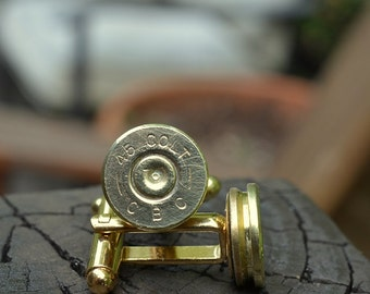 Bullet cufflinks fashioned from repurposed gold/brass CBC .45 Long Colt shell casings