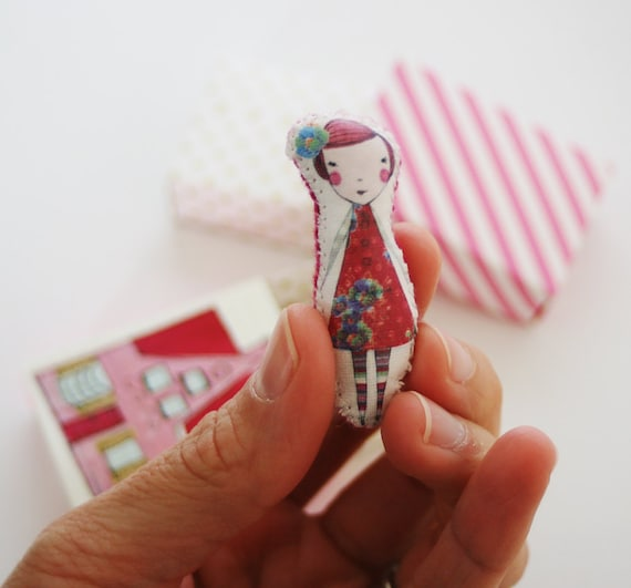 Miniture Camille pocket doll in her little matchbox home