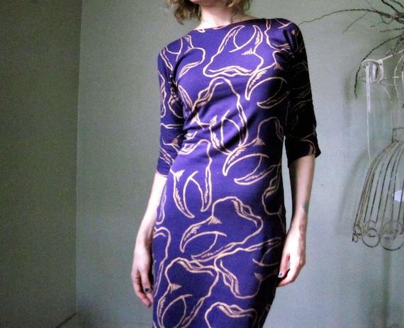 https://www.etsy.com/listing/161497731/purple-jersey-dress-with-metallic-gold