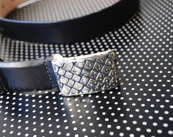 Luxurious vintage 80s black genuine shiny leather belt with silvertone metal  modernist buckle. Made by Doncaster. Size Large.