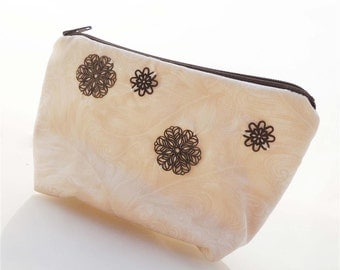 Brass Medallions on Ivory Zippered Pouch