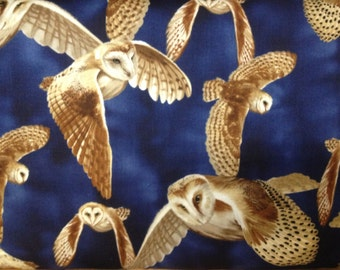 100 percent cotton fabric Brown Owls in Flight on Blue Background. Price is per Fat Quarter.
