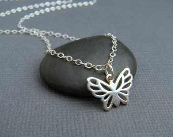 silver butterfly necklace. sterling silver necklace. simple jewelry. everyday. delicate. dainty. nature. small butterfly wings.