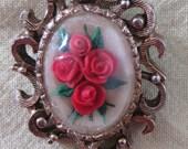 Elegant brooch with three dimensional roses, ca 1950