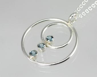 Double Circle Array Neck w-Stones (Blue Zircon)