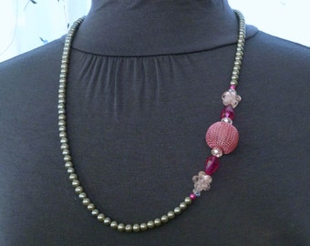 """Silver pearl necklace with a pink mesh ball surrounded by pink and crystal bead accents 29"""""""