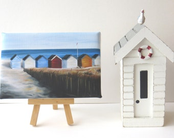 beach huts in a row by the sea, mini canvas art print