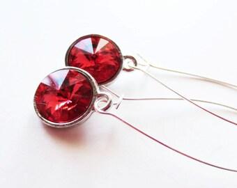 Peach rivoli earrings.  Long dangle silver earrings.  Crystal earrings.