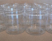 24  8 oz. clear plastic jars with silver metal cap with foam liners