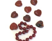 red stone beads and heart beads