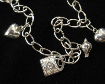 Sterling Silver Fashion Charm Bracelet with Hearts, Shells, Locks, and a Bell