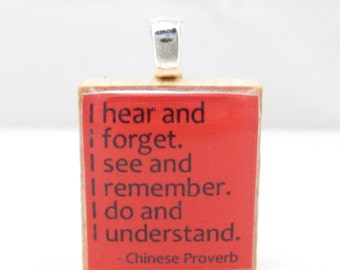 Chinese proverb about education -  I do and I understand - red Scrabble tile