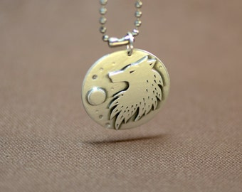 Rush of the wild wolf sterling silver medallion