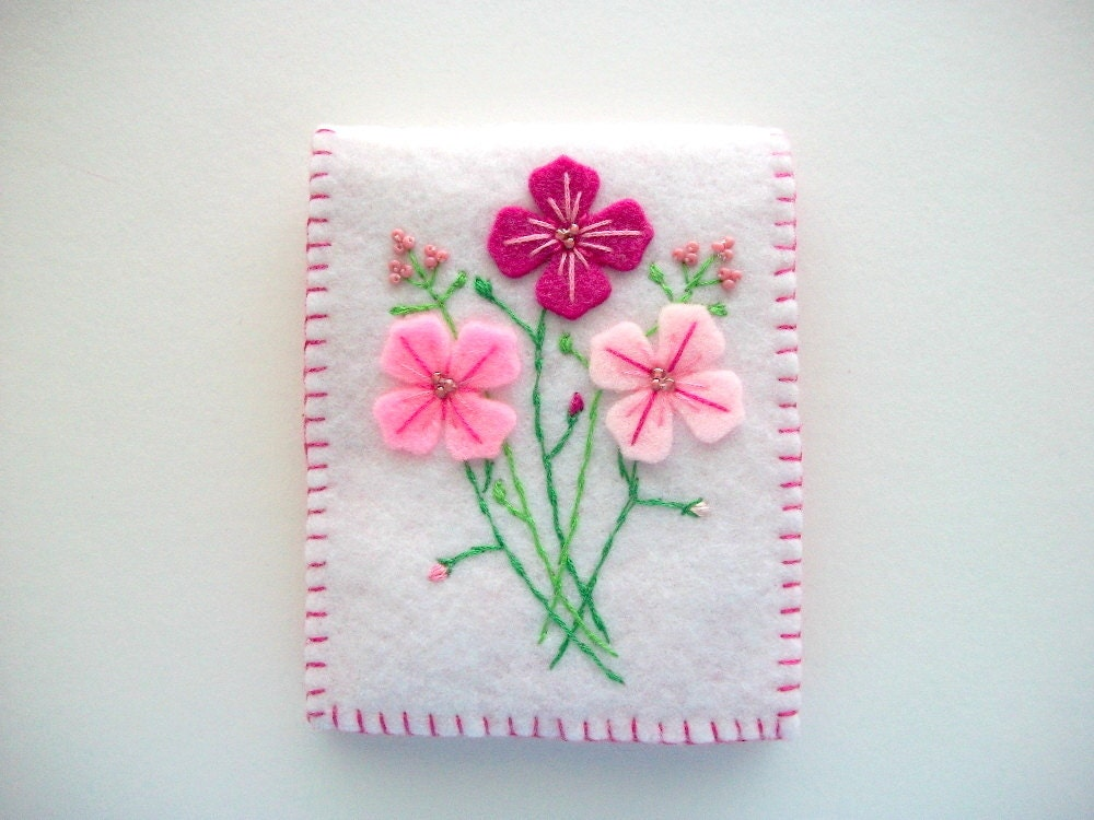 White needle book with hand embroidered felt flowers sewn