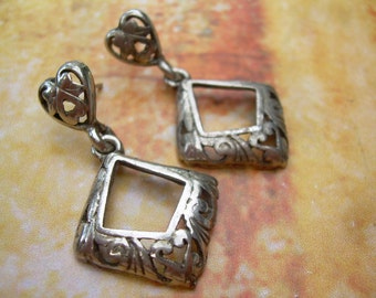 Beautiful Pair of Vintage Dangle earings for pierced ears, With Lovely designs in the silver
