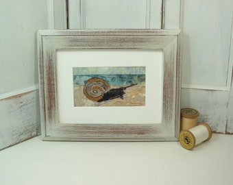 Snail at the Beach - framed fabric collage