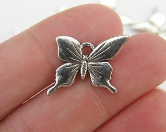 8 Butterfly charms tibetan silver A325