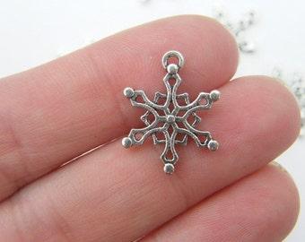 10 Snowflake charms antique silver tone SF16