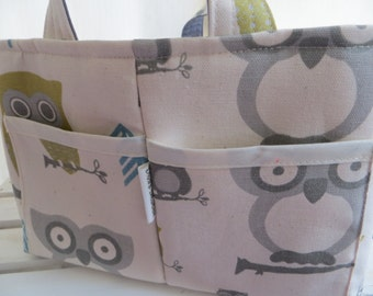 Add matching side pockets for your purchased diaper caddy or fabric organizer bin