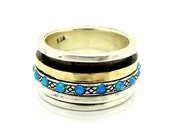 Wide spinner ring with opal, silver & gold hammered bands