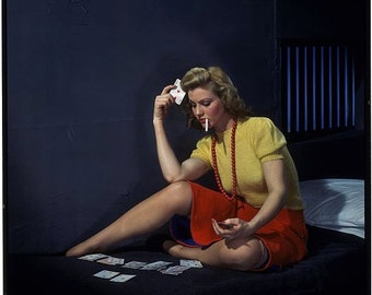 Woman in cell playing cards. 50's era color image. 8 1/2 x 11 reproduction image.