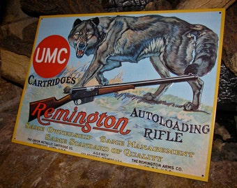 Vintage 1991 Embossed Tin Sign Advertising Remington Autoloading Rifle / UMC Cartridges / Ammunition / Remington Arms Company / Wolf