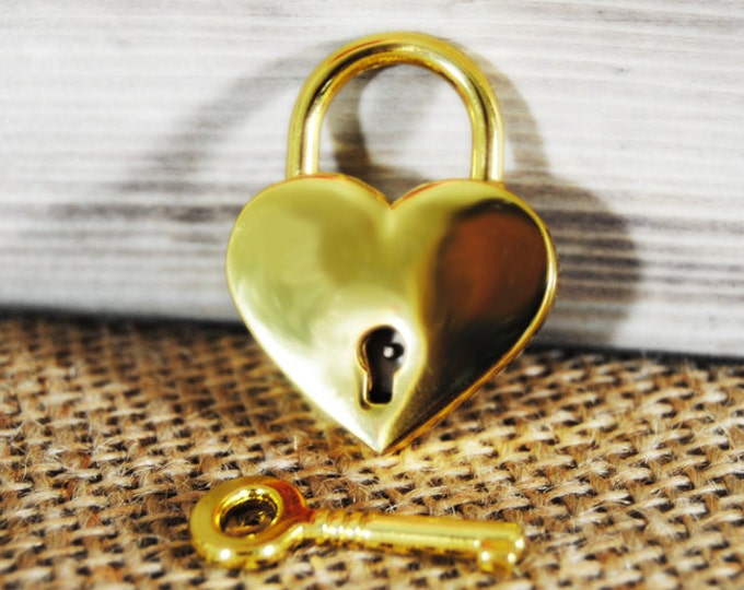 Heart shaped lock with key and latch