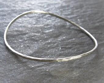 Fluide: Hammered Silver Bangle. Curved Bangle. Hammered Silver Bangle. Recycled Argentium Sterling Silver, Stacking Bangle. Gift Under 50