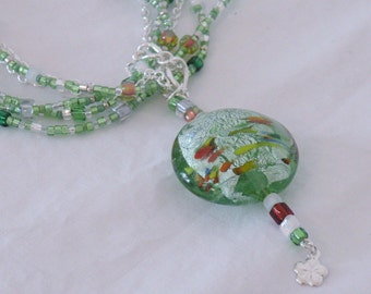 Charge of the Light Green  Glass Multi-Strand Necklace