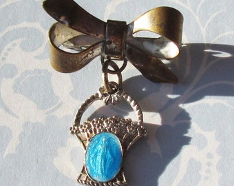 Vintage Brooch: Bow with Enamel Blue Basket of Flowers with Virgin Mary