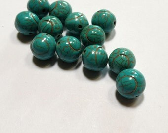 Turquoise Beads - 10mm howlite carved ovals - 12 beads