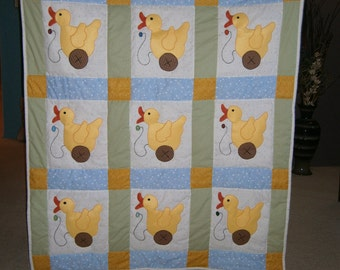Toy Duck baby quilt with blue and green accents