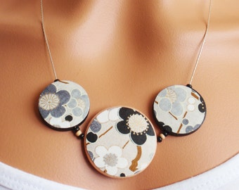 Grey, white and black wooden necklace with traditional Japanese paper decoupaged onto wooden beads