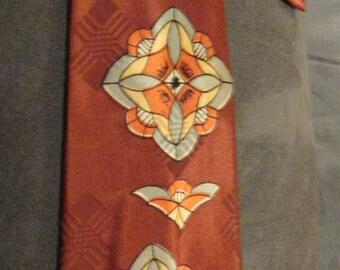 Lord Furnival Cravat by Wormser / Vintage Men's Necktie / Satiny Rust Tie with Abstract Sun Bursts