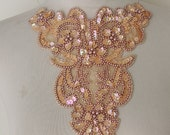 Cute  beaded and   embroidered  applique with  sequence    1 pieces listing 7 1/2 inches wide at the neck 8 inches down the center