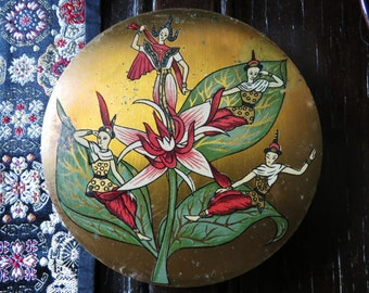 Vintage Vogue Vanities compact - brass case with Siam lily design