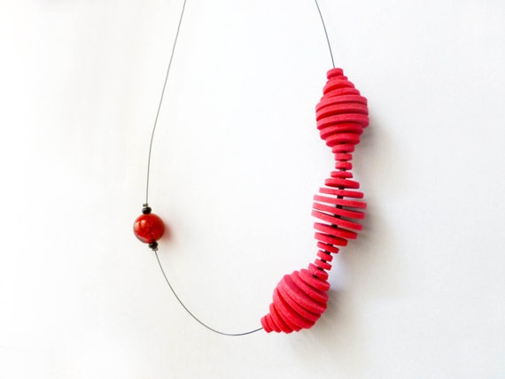 geometric minimal necklace with red circles and a red dot - contemporary jewelry