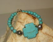 Stretch Turquoise Magnesite Cross Bracelet with Turquoise Magnesite and Silvertone Beads