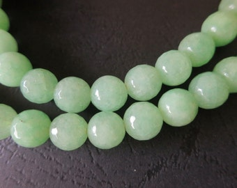 2 str -Jade in Light Green 10mm Faceted round Beads