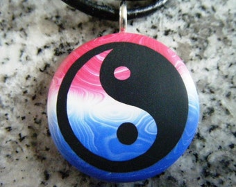 Yin Yang symbol hand carved on a polymer clay Red White and Blue color background. Pendant comes with a FREE necklace
