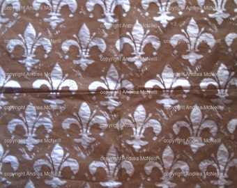 Sheet brown tissue paper, handprinted with silver Fleur de Lys linoprint