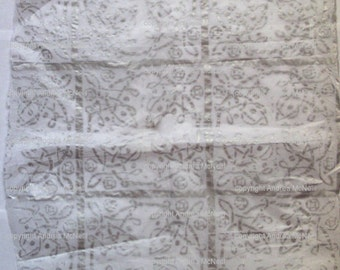 Sheet of white tissue paper, hand printed in silver celtic knot design.