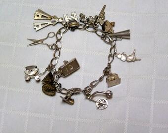 Vintage Silver 14 articulating charms bracelet