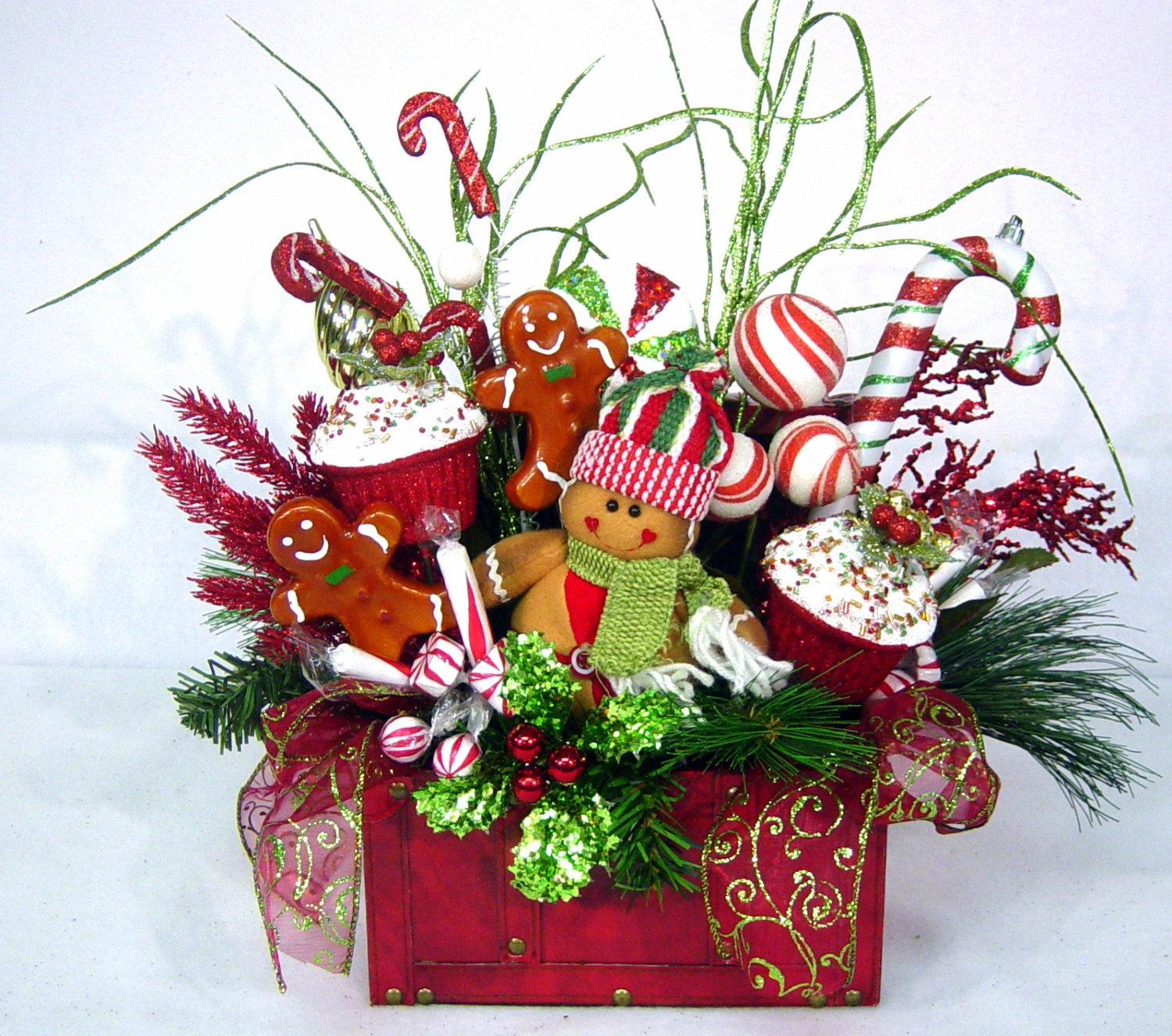 Gingerbread sweet treat christmas floral arrangement holiday