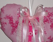 Pink fabric heart with ribbons,lace