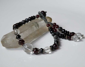 Clear Crystal gemstone bracelet with pink n black Tourmaline - grey Larvikite - Garnet - tassel - macrame closure - silver colored cord